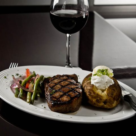 Wrought Iron Grill Owosso. Michigan fine dining restaurant New York Strip steak with red wine